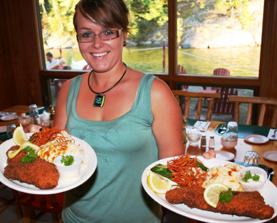 Waitress Holding Two Plates Of Chef Prepared Food