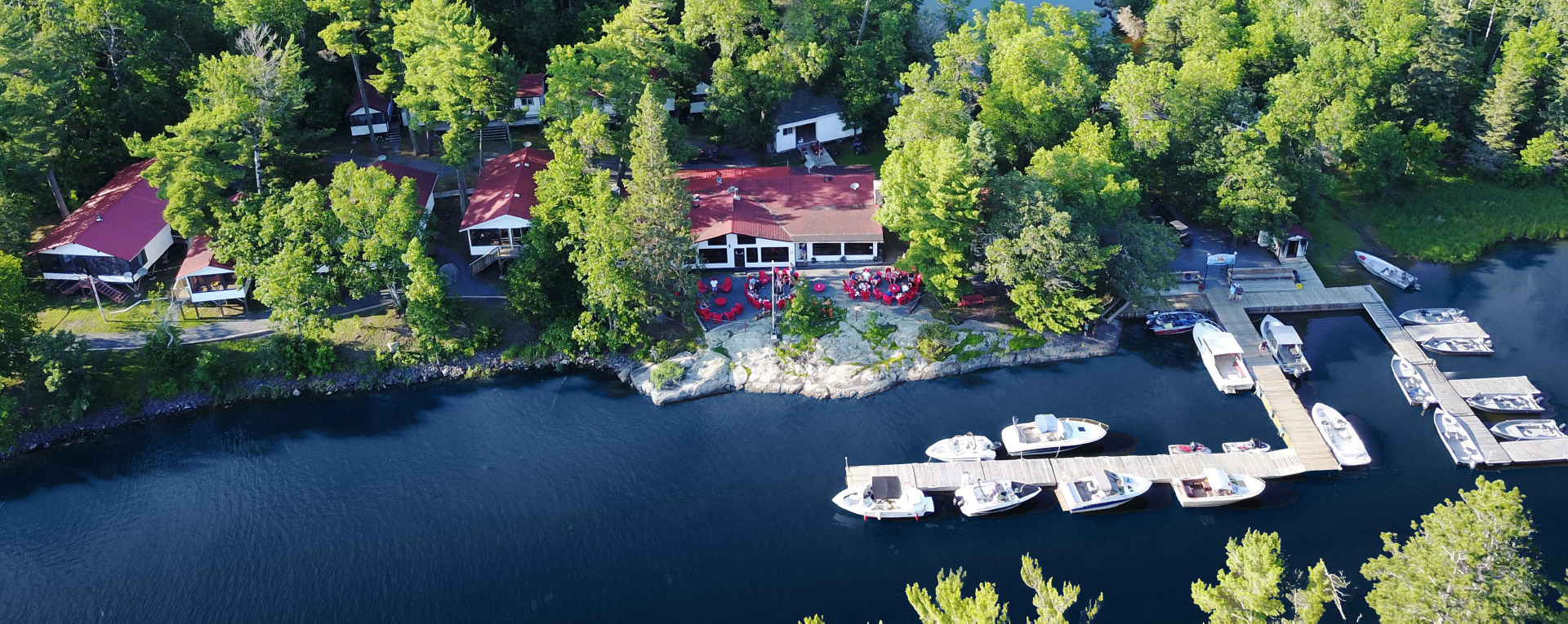 Aerial View of Crow Rock Lodge and Boats by Dock