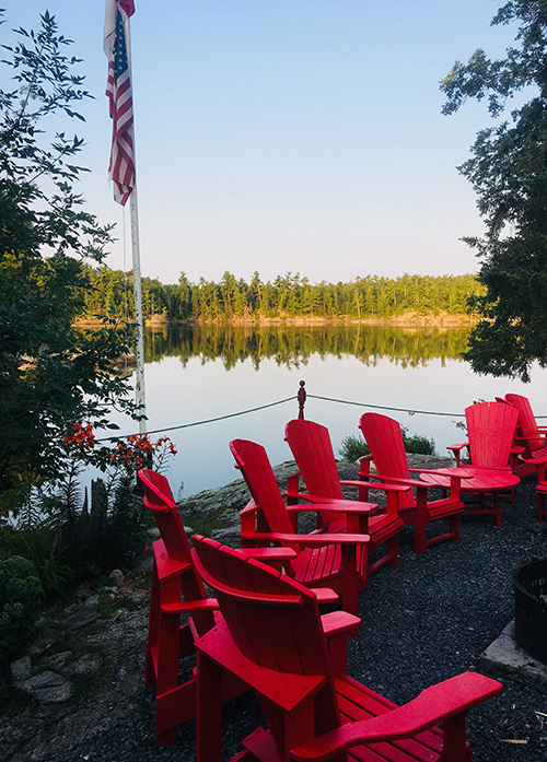 Muskoka Chairs Around the Fire by the Lake